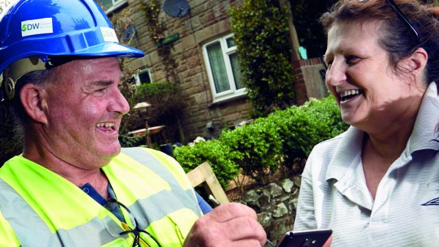Worker smiling and talking to customer